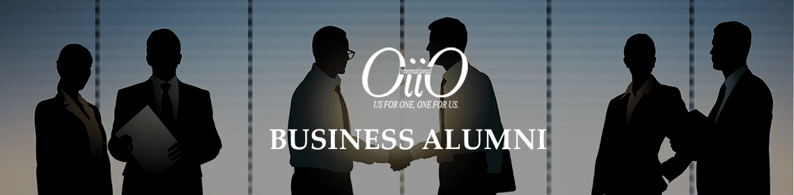 Business Alumni - they are shaking hands.